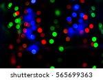 blurred bokeh lights background ... | Shutterstock . vector #565699363