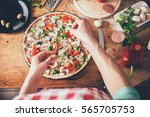 woman preparing pizza in the... | Shutterstock . vector #565705753