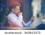 businessman looking at digital... | Shutterstock . vector #565815373
