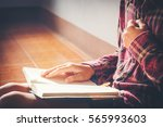 man praying on holy bible in... | Shutterstock . vector #565993603