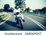 motorcyclist ride  leaning on a ... | Shutterstock . vector #566069347
