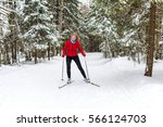 cross country skiing woman in... | Shutterstock . vector #566124703