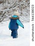 little boy in winter clothing... | Shutterstock . vector #566138023