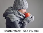 Woman Drinking Hot Drink To...