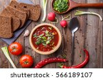 beet soup in wooden plate with... | Shutterstock . vector #566189107