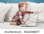 Adorable Baby With Laptop....