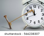 time on clock stop by nail ... | Shutterstock . vector #566238307