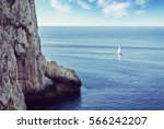 lonely sailboat sailing on the... | Shutterstock . vector #566242207