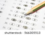 Small photo of optical form of standardized test with answers bubbled and a black pencil examination,Answer sheet,education concept,selective focus,vintage color