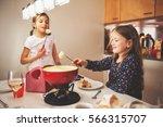 two kid girls eating swiss ... | Shutterstock . vector #566315707