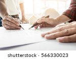 architects engineer discussing... | Shutterstock . vector #566330023