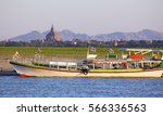 boats and pagoda in bagan  ... | Shutterstock . vector #566336563