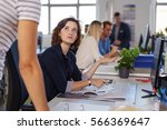 young businesswoman in a... | Shutterstock . vector #566369647