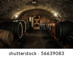 Wine barrels in traditional wine cellar - stock photo