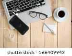 wooden desk with various... | Shutterstock . vector #566409943