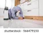exterminator in workwear... | Shutterstock . vector #566479153