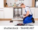 repairman sitting near... | Shutterstock . vector #566481487