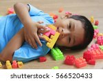 little boy playing with lots of ... | Shutterstock . vector #566520433