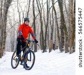 mountain biker resting bike on...   Shutterstock . vector #566575447
