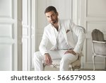 elegant young handsome man with ... | Shutterstock . vector #566579053