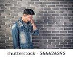sad asian young man portrait... | Shutterstock . vector #566626393