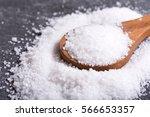 sea salt in a wooden spoon on... | Shutterstock . vector #566653357