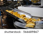 fresh baguettes out of the oven ... | Shutterstock . vector #566689867