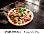 hot pizza with meat  basil and... | Shutterstock . vector #566708443