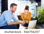 young businessman and woman sat ... | Shutterstock . vector #566756257