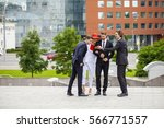 four business people outside... | Shutterstock . vector #566771557