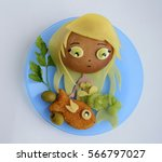 Small photo of Sandwich in the form of the mermaid. Chib. Sandwich is made of a roll, cheese, a kiwi. Creative food for children.