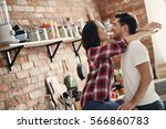 lovely couple in the kitchen | Shutterstock . vector #566860783