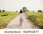 Woman Cycling On Vintage Bicycle