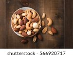mix cocktail nuts with salted... | Shutterstock . vector #566920717