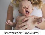 mother holding her newborn baby ... | Shutterstock . vector #566938963
