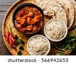 chicken tikka masala spicy... | Shutterstock . vector #566942653