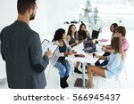 back view of male recruiter... | Shutterstock . vector #566945437