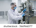 worker on factory in white suit ... | Shutterstock . vector #566966377
