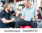 senior man working out with... | Shutterstock . vector #566984737