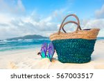 beach accessories on turquoise... | Shutterstock . vector #567003517