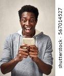 black man with smartphone | Shutterstock . vector #567014527