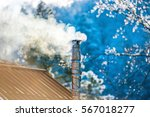 smoke from the chimney on the... | Shutterstock . vector #567018277