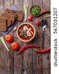 beet soup in wooden plate with... | Shutterstock . vector #567031207