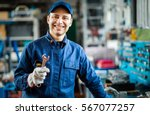 auto mechanic smiling in his...