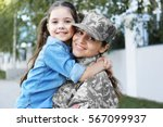 mother in army uniform and... | Shutterstock . vector #567099937