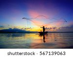 Silhouette Of Fishermen Using...