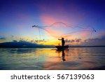 Silhouette Of Fishermen Using...