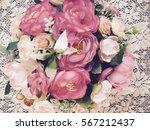 plastic flowers in the vase of... | Shutterstock . vector #567212437