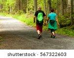tourist family strolling along... | Shutterstock . vector #567322603