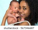 happy african mother holding... | Shutterstock . vector #567346687